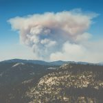 An image of a mountain with smoke from wildfire.